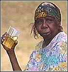 Aborigine woman with a beer